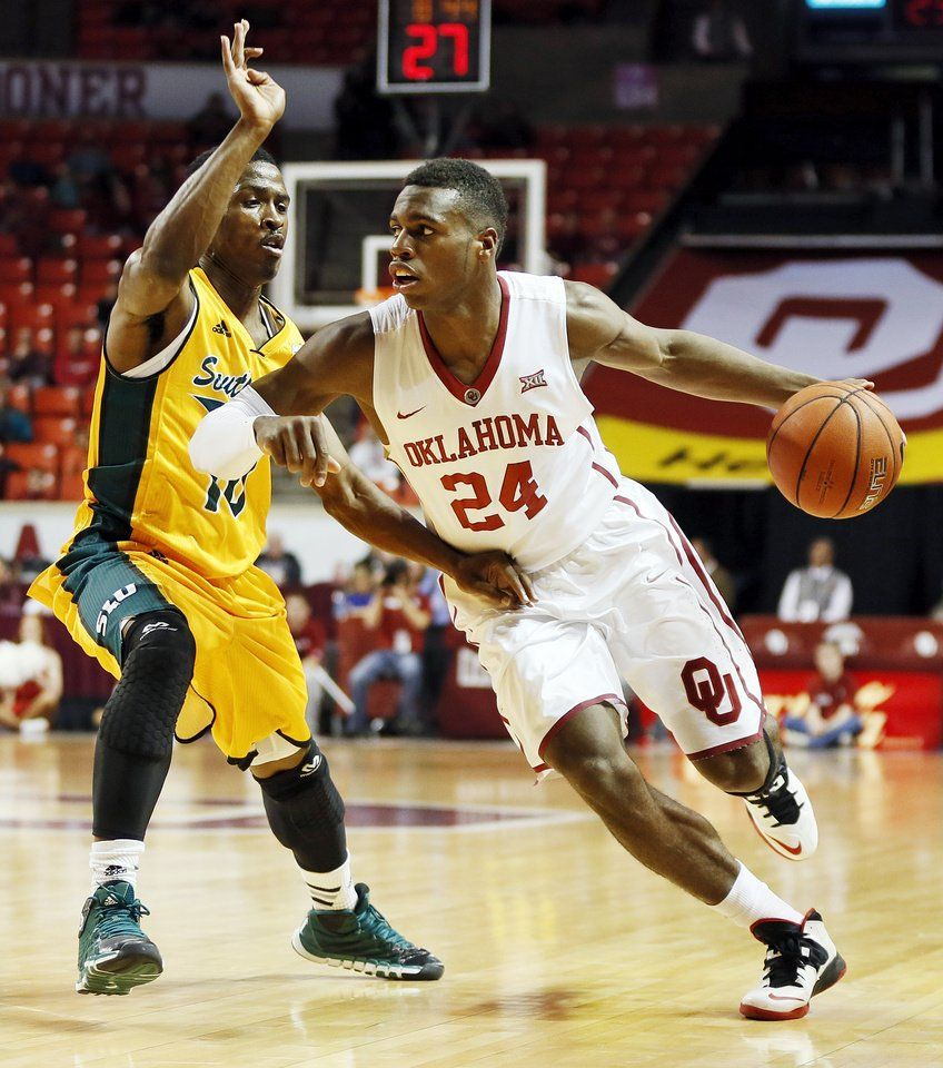 Oklahoma S Buddy Hield 24 Drives Against Southeastern Louisiana S Zay Jackson 10 During A Men S College College Basketball Game Sooners College Basketball