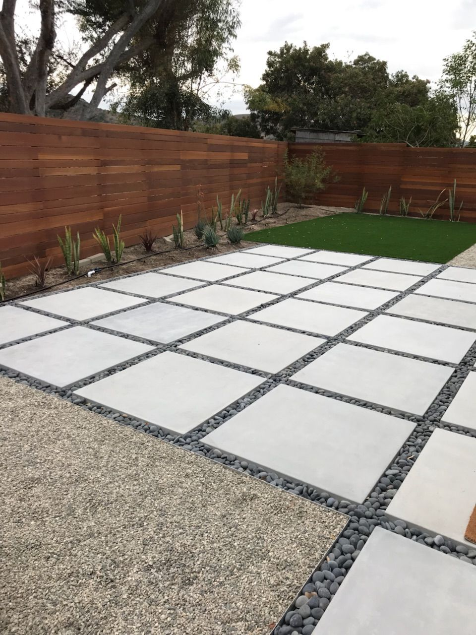 concrete pavers modern backyard