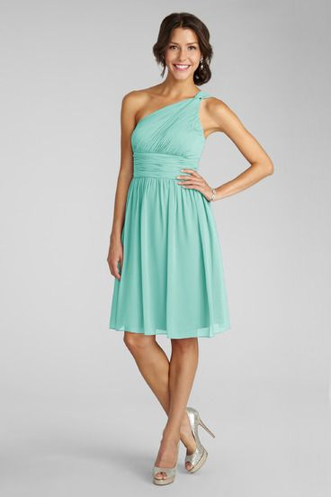 9832ceff2eee Subtle ruching highlights this flowy one shoulder spearmint chiffon dress  with a flattering set in waist.