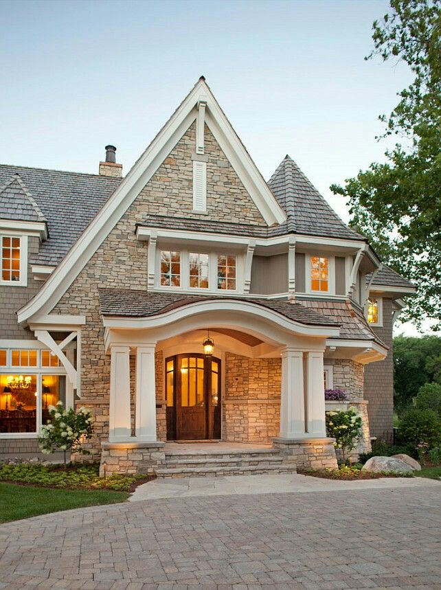 shingle siding stone veneer and an eyebrow porch roof stone exterior houseslarge homes exteriorbrick home exteriorsluxury