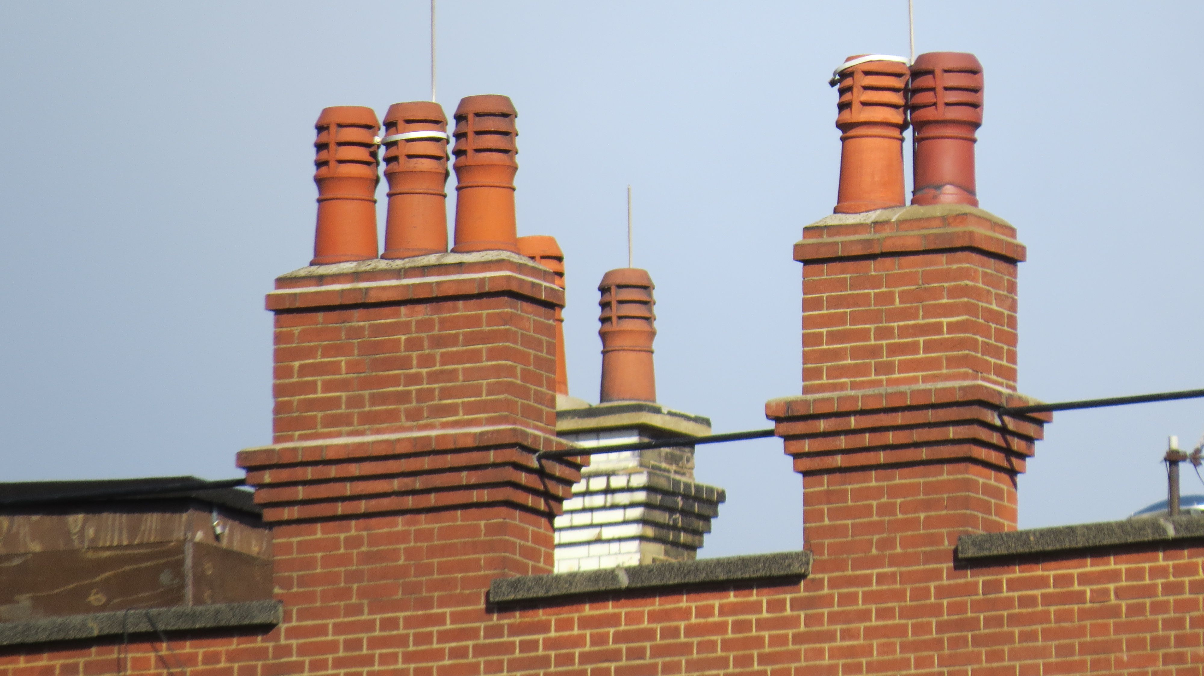 A Medley Of Terracotta Chimney Pots Dons Rooftops In Downtown London Pipes For Sale Chimney Cap Clay