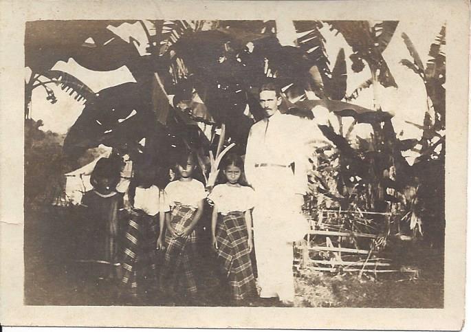 H. E. Hostetter & Native Children at Bugason, Antique, Philippines.
