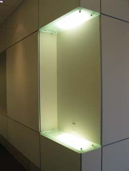 Glass Corner Shelf Installed With Standoffs And Recessed Lighting