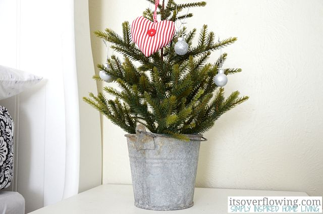 Ikea tree in galvanized bucket itsoverflowing christmas
