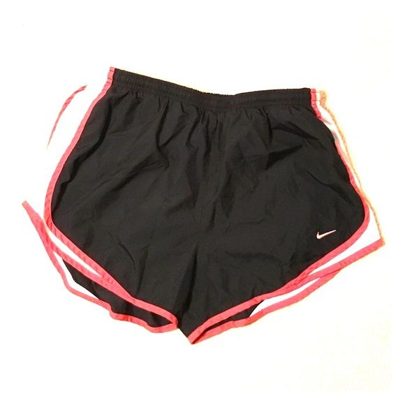 Nike Running Shorts Coral trim, black shorts, white sides. Comfortable with panty lining. Used but in good condition. Nike Shorts