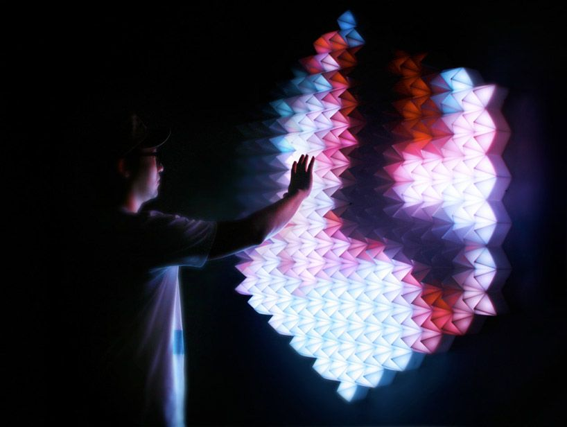 """""""'new angles' is an interactive light installation by shanghai-based design studio, super nature. The hexagonal object features a crystallized surface which flickers and blinks in a multitude of colours [. . .] The installation aims to create a visual dialogue with the viewer, at times mimicking and reflecting [their] actions."""" via Designboom"""