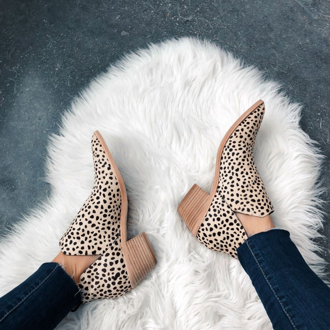 41f65ad9c7 Blogger Sarah Lindner of The house of sequins wearing leopard Dolce Vita  Sonni booties. Fall Leopard shoe round-up