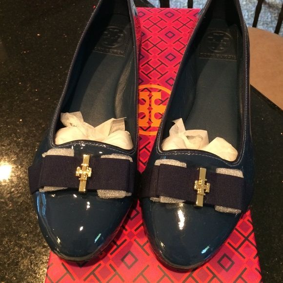 NWT Tory Burch Trudy Flat. Patent leather. Navy blue. Grosgrain ribbon bow in front with gold TB logo. Comes with box and dust bag. This style runs small. Tory Burch Shoes
