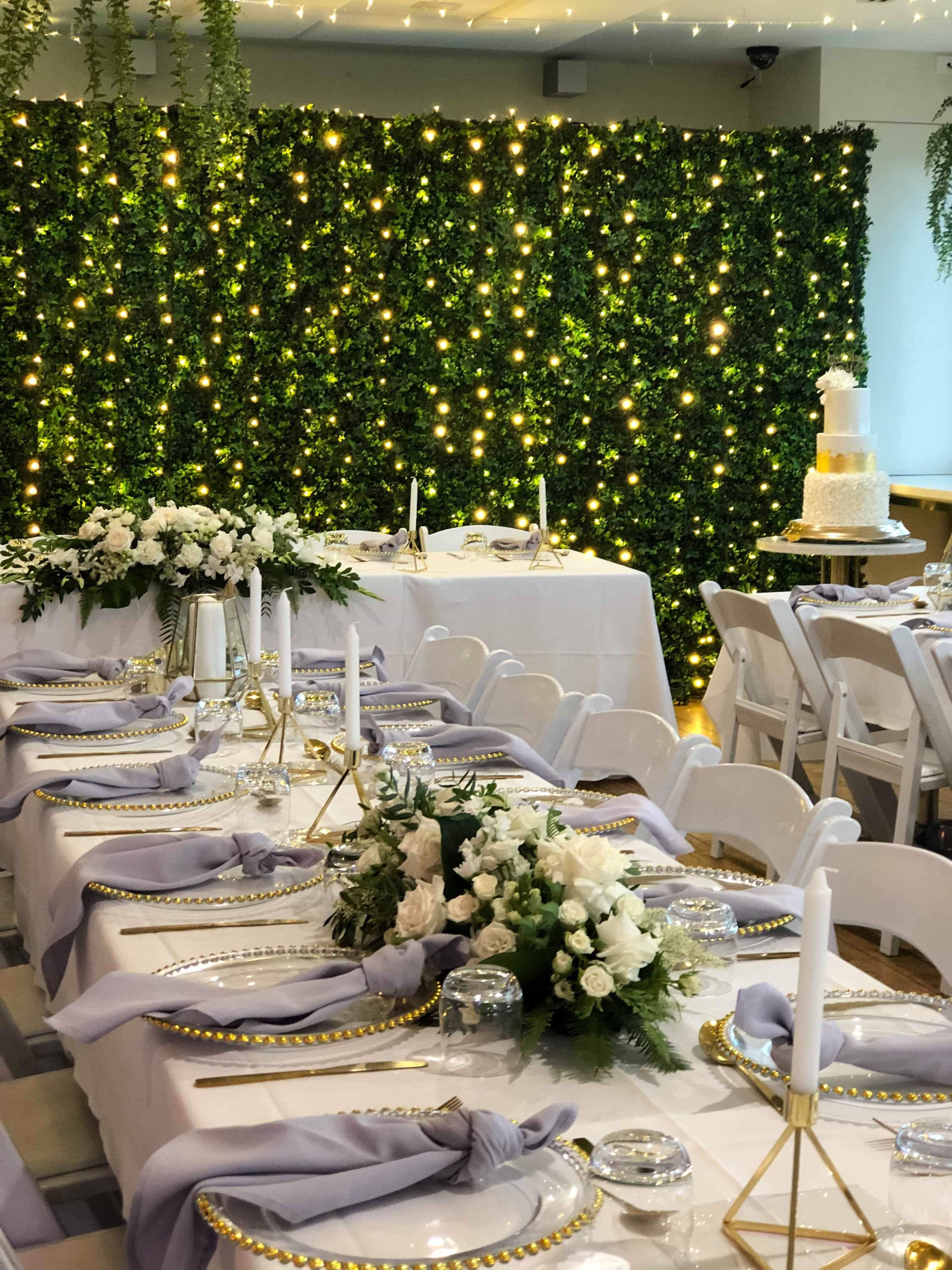 Amazing green wall backdrop. Weddings on the river at ...