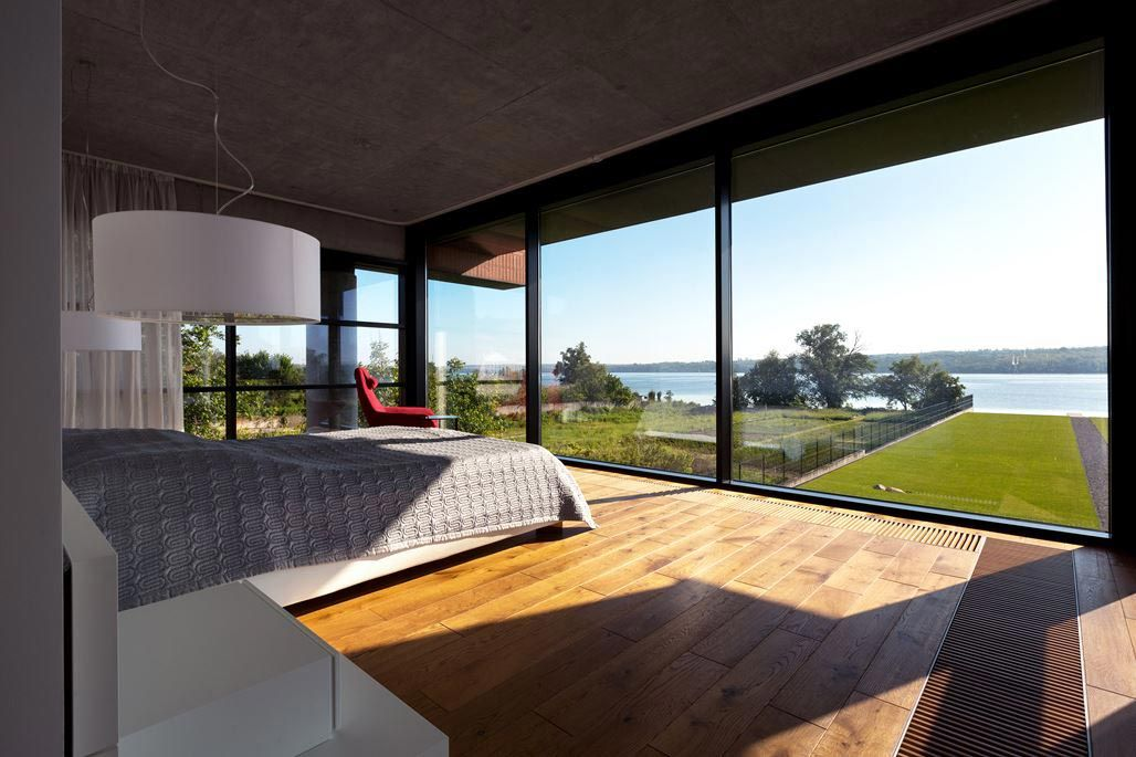 Modern brick house designed to offer spectacular lake views from all the  rooms that have lake