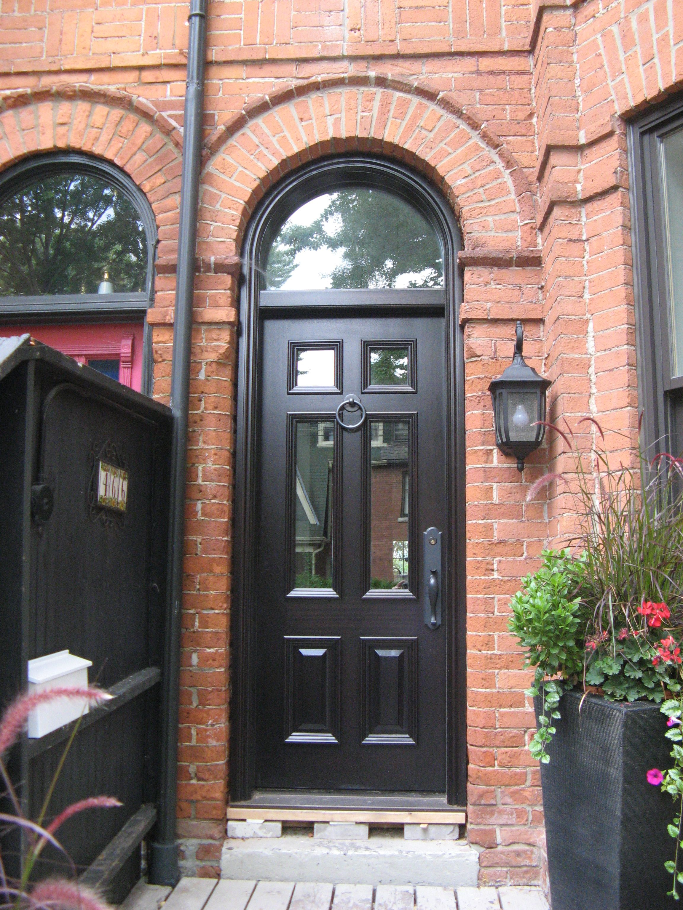 This Charming Urban Home Features A 6 Panel Amberwood Mahogany #door, With  4 Glass Panels And A Matching Round Top Transom.