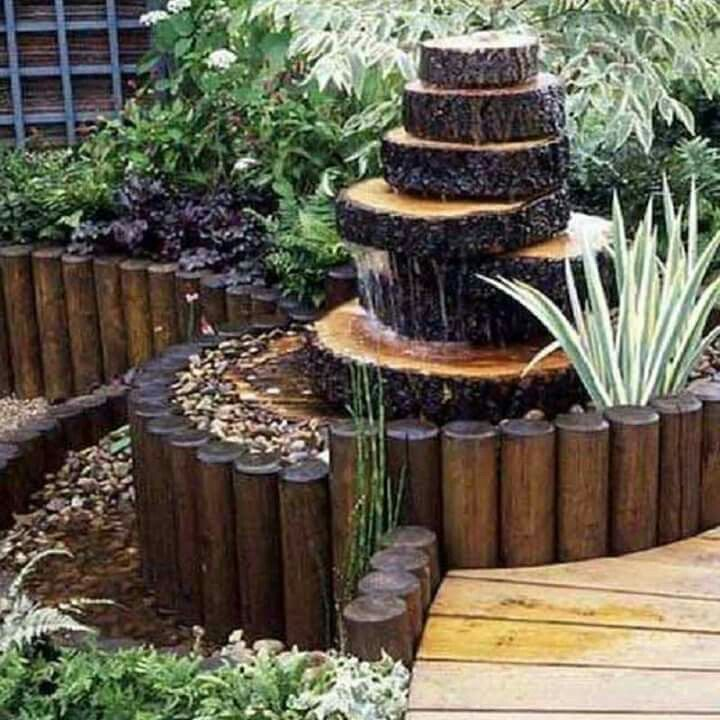Tree stump fountain pinteres for Tree decorations for garden