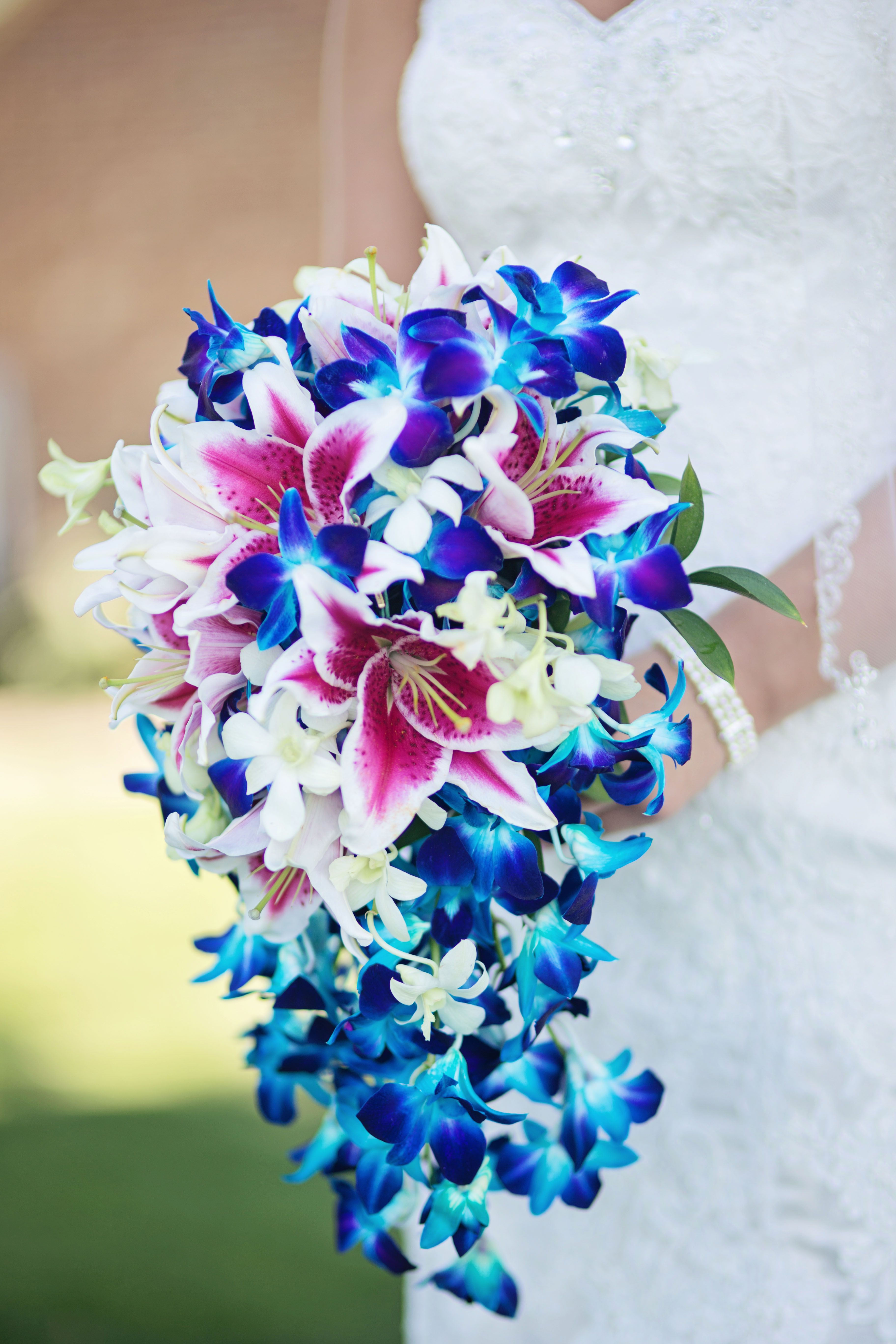 Blue dendrobium orchids with pink lilies for bridal bouquet blue