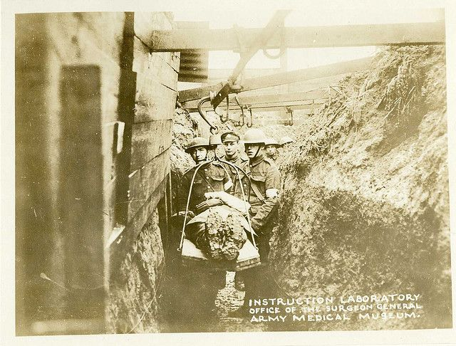 Bringing wounded through the trenches using an overhead cable. British trench trolley. World War 1.