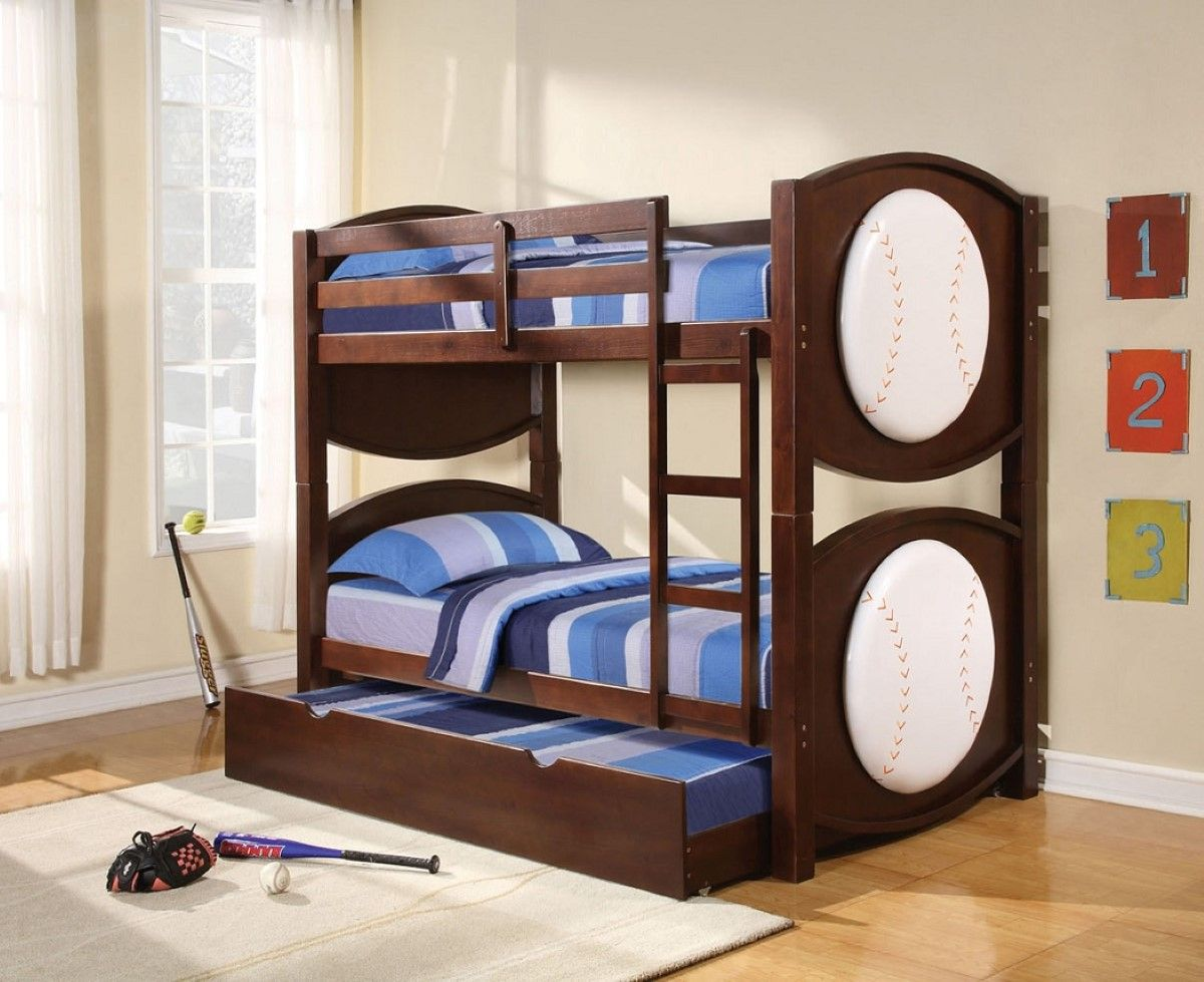 Loft bed with desk and trundle  Chic wooden bunk beds with trundle designed with blue stripped quilt