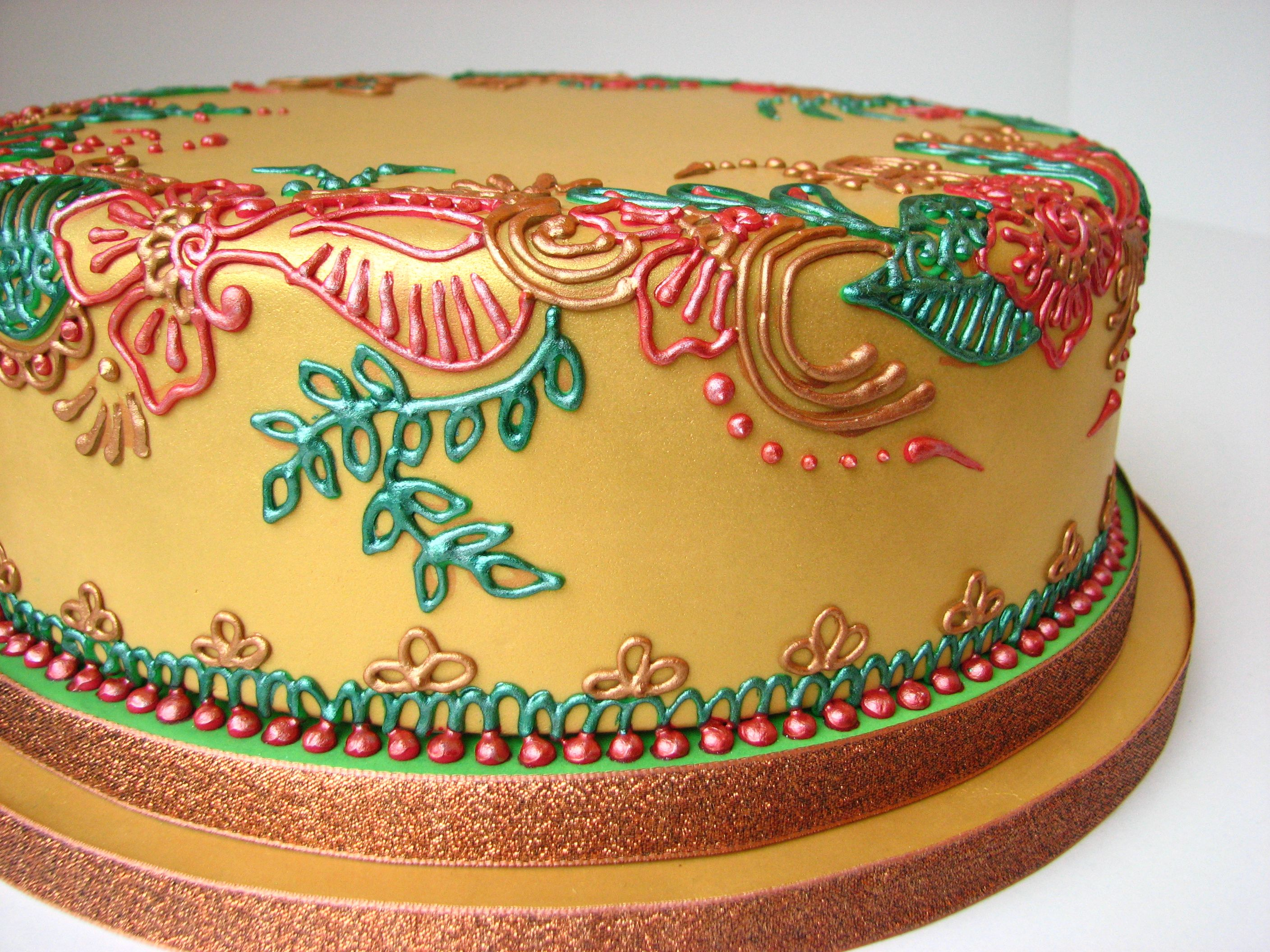 Mehndi Patterns For Cakes : A gold henna mehndi cake with red green and bronze