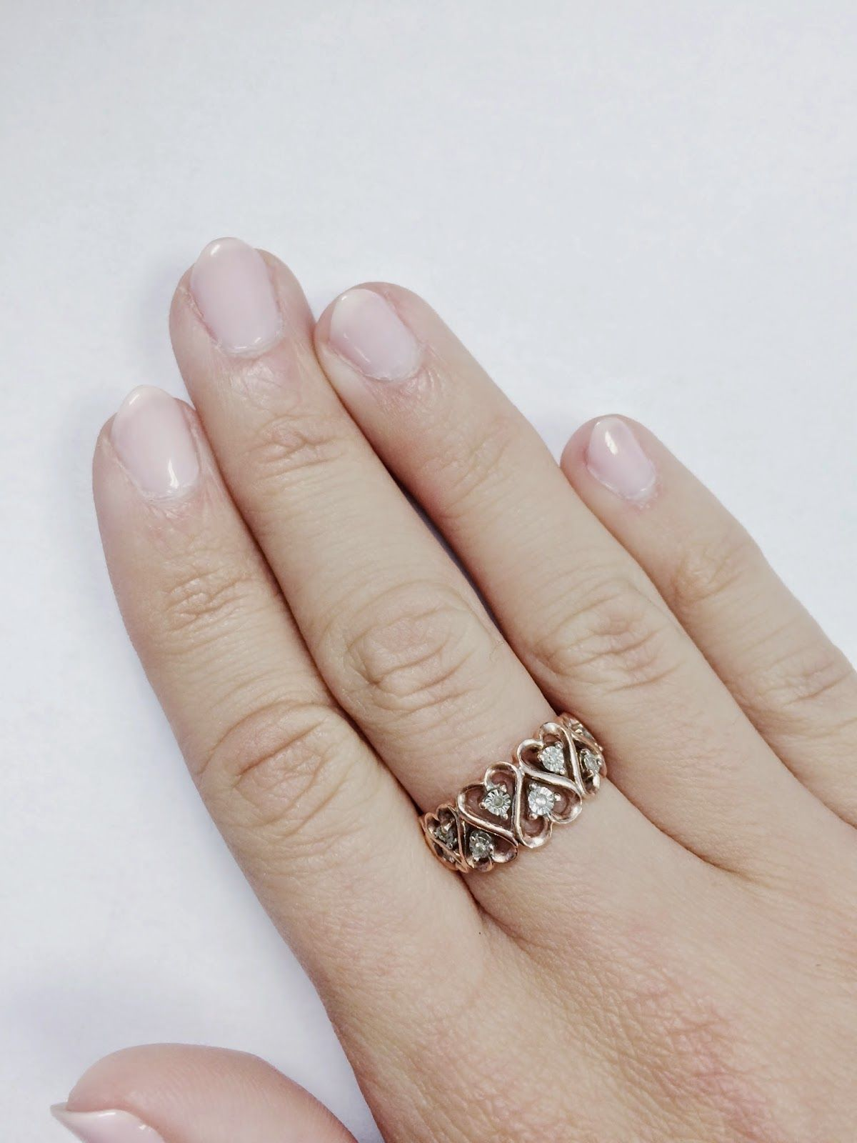 dainty, minimalist rose gold diamond heart ring