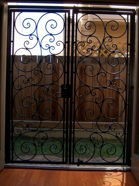 Iron French Door | French doors security, Wrought iron ...