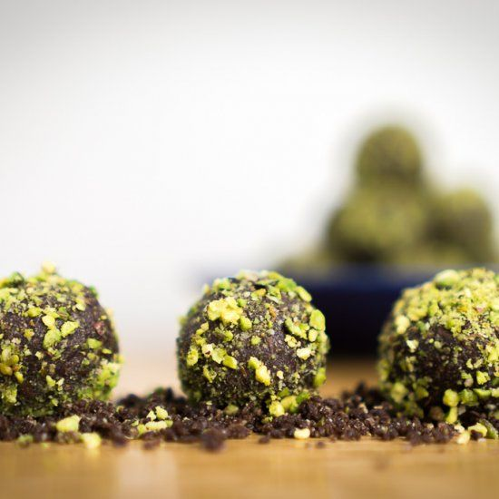 Super Energy Bites rolled in pistachio pack a punch with nuts, coconut, dates, cacao and Mayver's Super Spread with chia seeds.