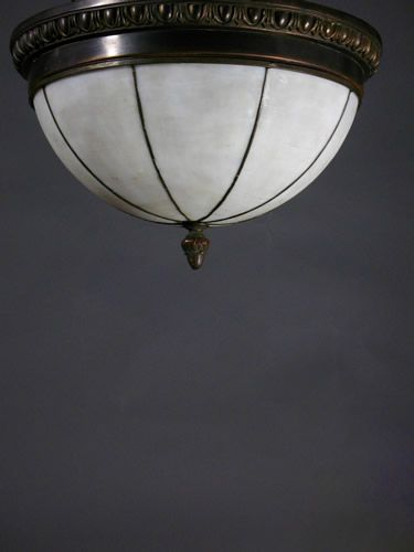 Circa 1915 very nice period detail in minimal form gives this antique lighting fixture many