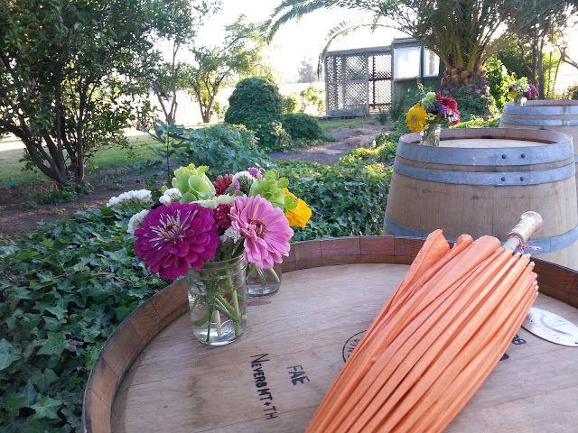 Flowers on top of barrels