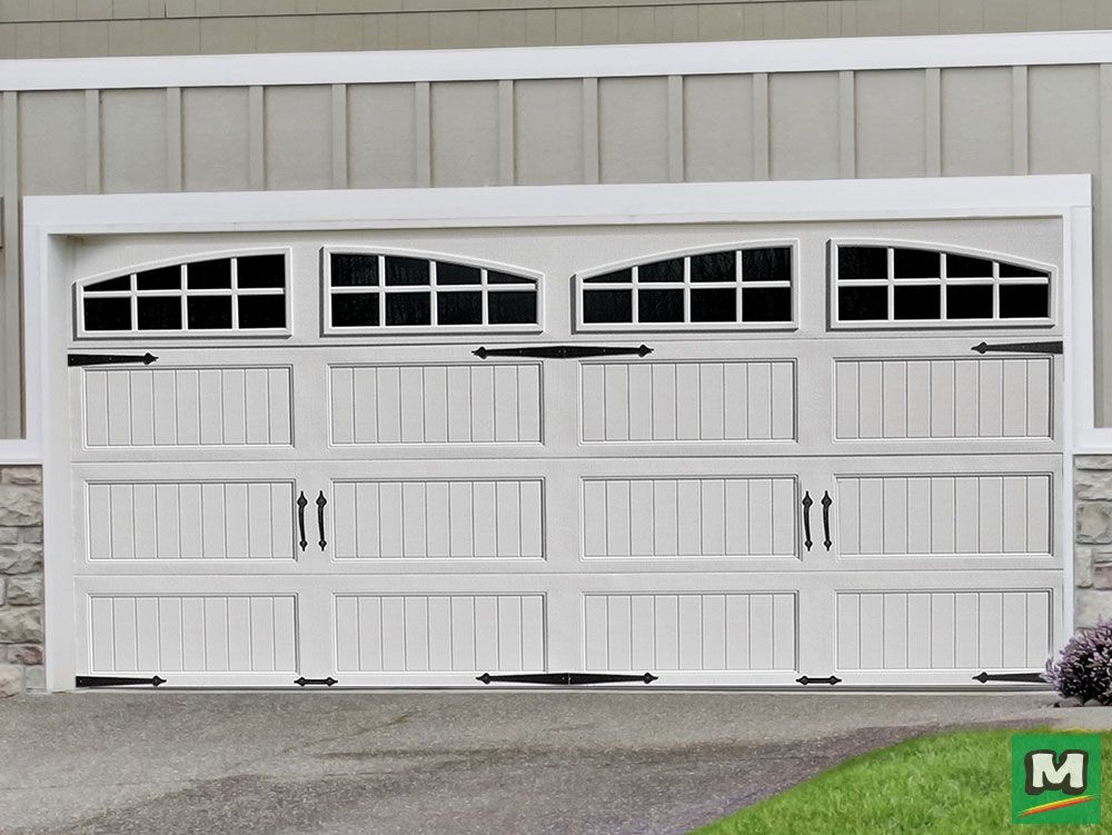 This Ideal Door Designer Steel Panel Garage Door Features Versatile Grooved Panel Designs And Arched Windows Garage Door Styles Garage Doors Garage Door Types