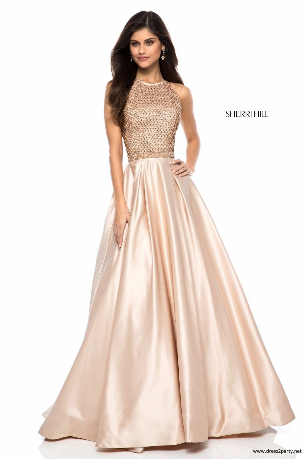 824f4136918 Halter neck satin ball gown from the Sherri Hill 2018 collection. We love  the nude colour in this style