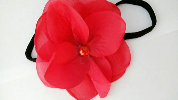 Check out this item in my Etsy shop https://www.etsy.com/listing/510059786/elastic-flower-hair-band