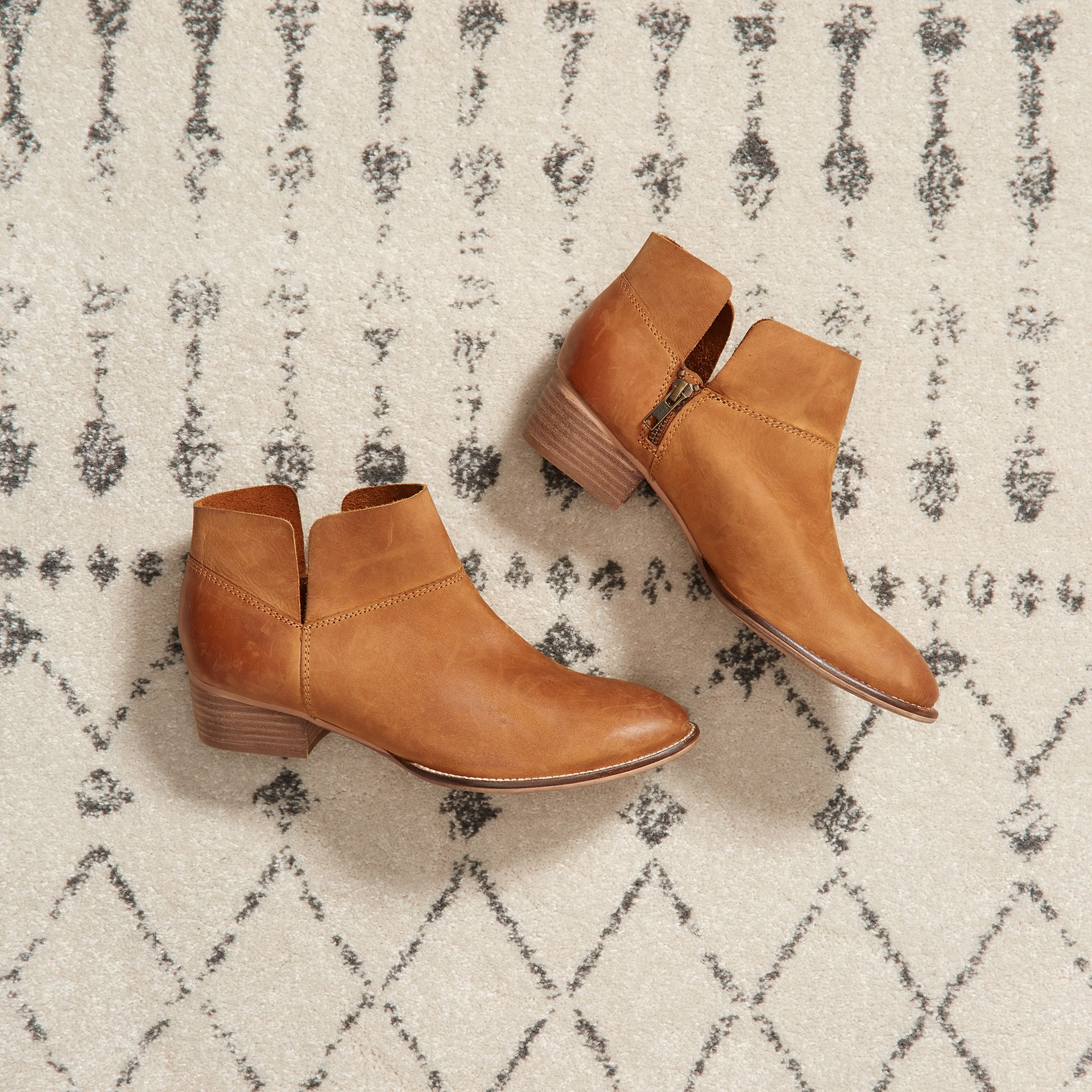 Don't give your boots the boot this spring. Wear them with sundresses, shorts, skinnies & more.