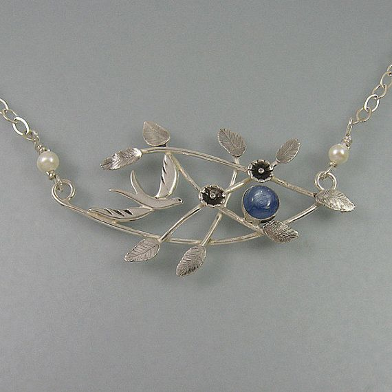 Bird necklace with branches, flowers and blue kyanite handcrafted from sterling silver by Kryzia Kreations