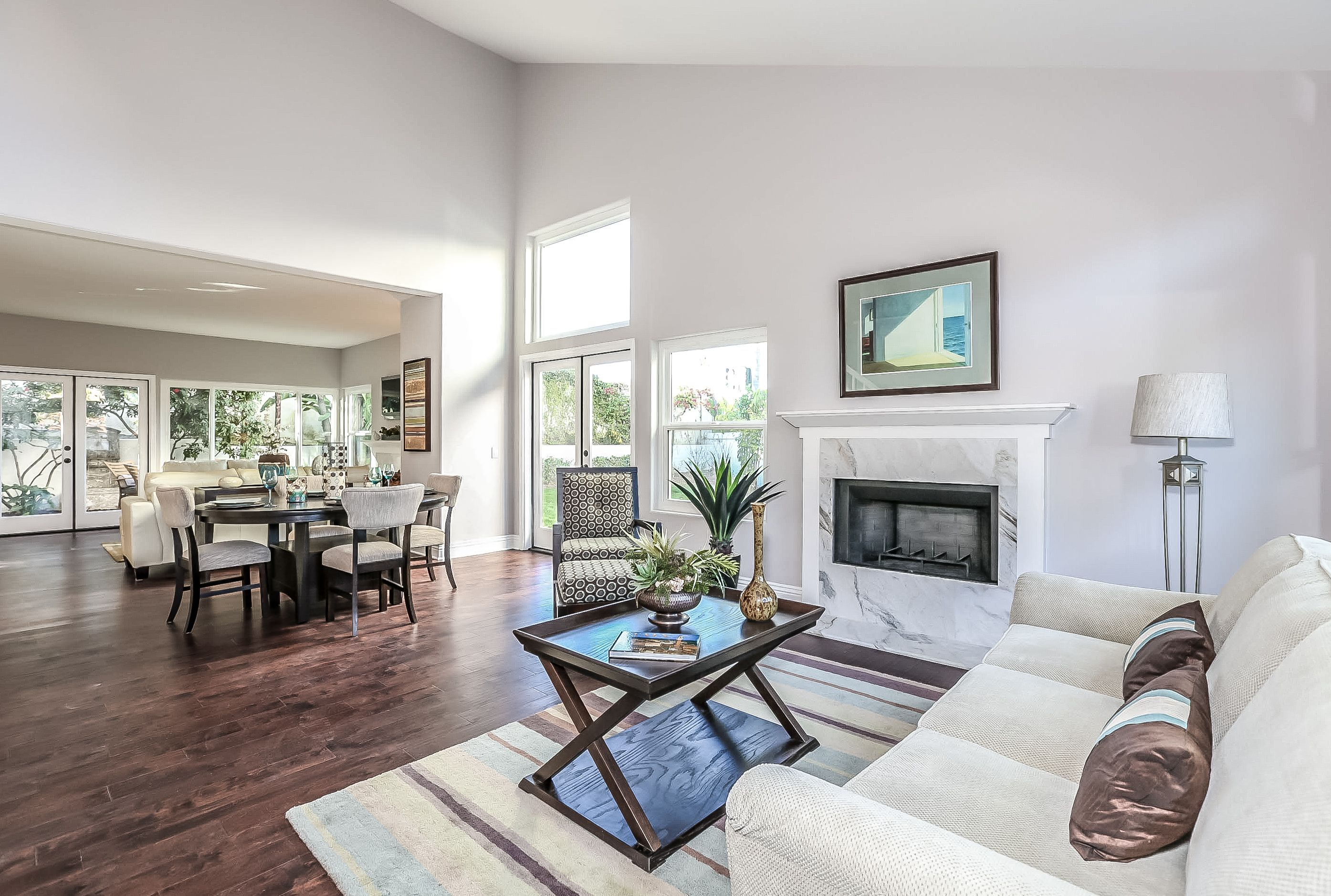 The bright and open living room and dining room features cathedral ...