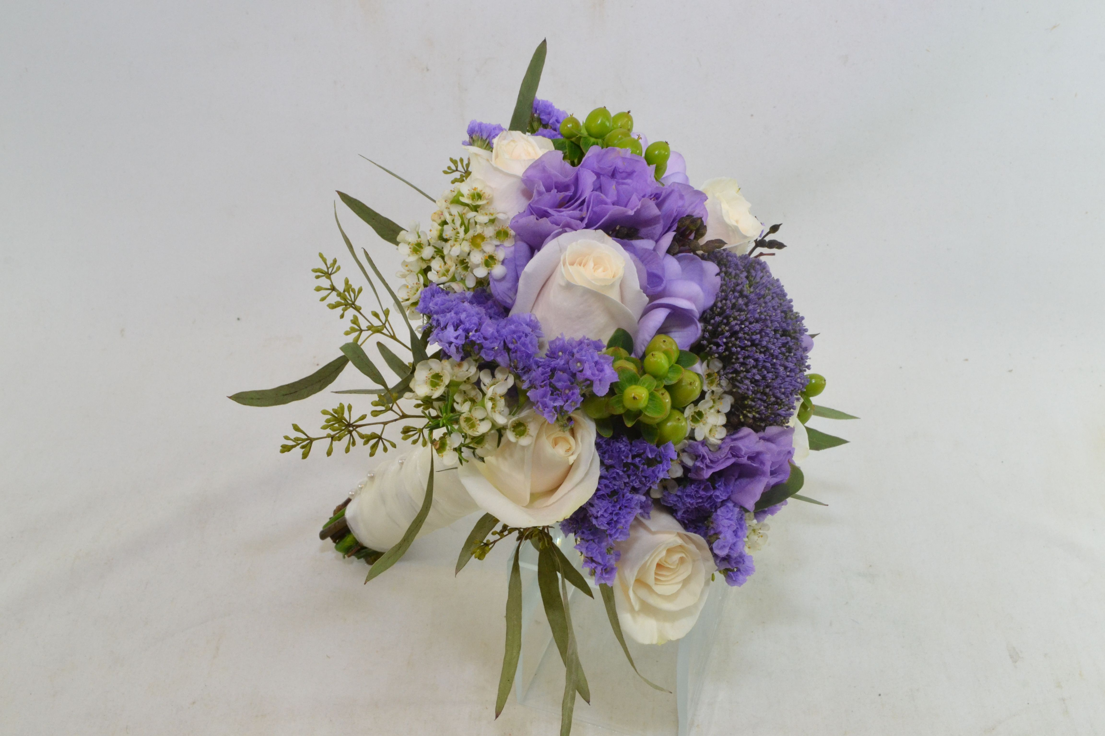 Purple, ivory and green for an on-trend look www.plushflowers.ca
