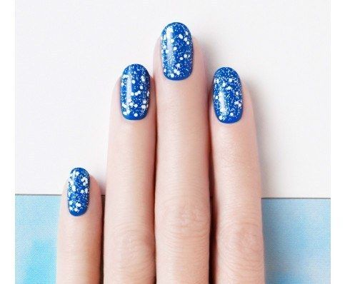 This topcoat makes it look like you applied meticulous polka dots. | 27 Lazy Girl Nail Art Ideas That Are Actually Easy