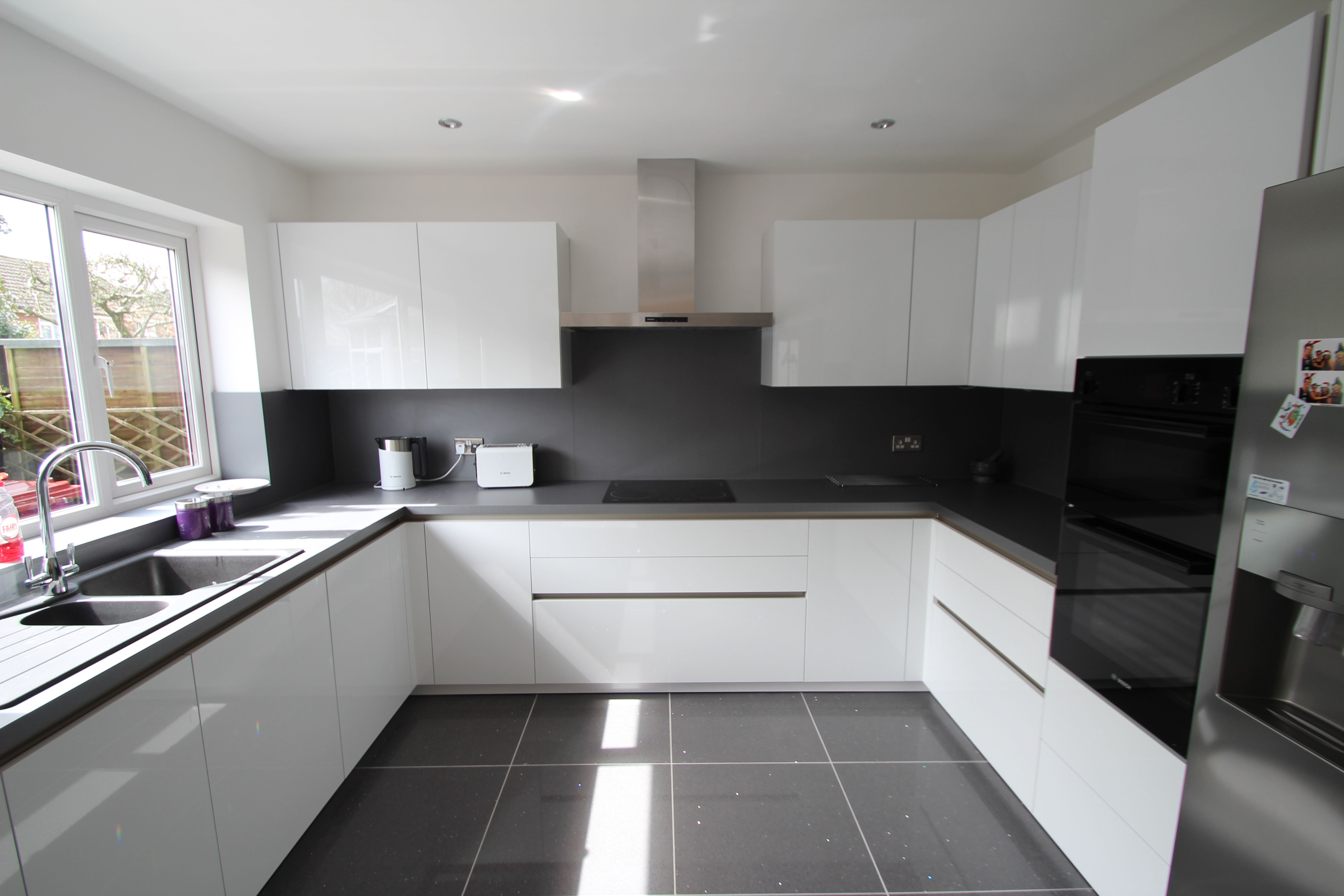 Schuller white gloss kitchen designed and installed by AD17 Design