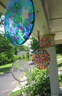 """Plastic sun catchers made from melted plastic beads. It is super easy to make these. Layer cheap plastic beads in cake pans (no lining required), melt at 400 for 20 minutes,let cool, & then just flip them out. Drill a hole in it to make it a suncatcher! Great """"craft"""" for kids (choose the colors, arrange them in the pans) to make as gifts for grandparents or teachers."""