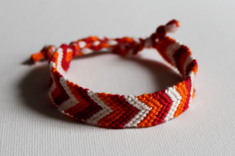 handmade / friendship / bracelet / chevron / pattern / white / orange / red / braided / ties