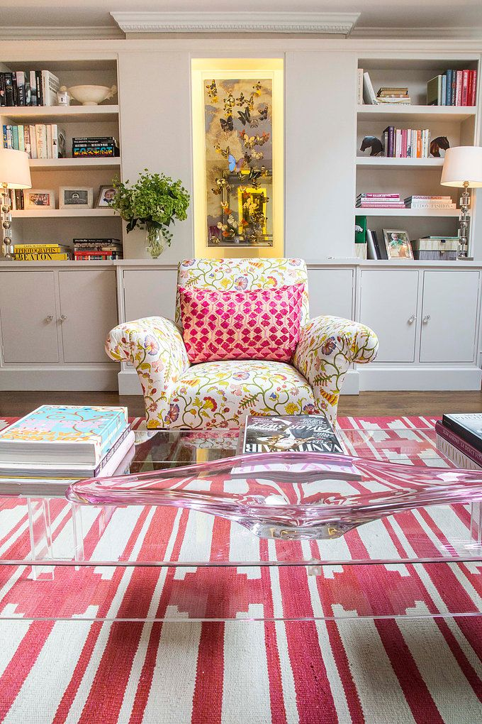 A fun and colourful living room with hot pink rug and colour ...