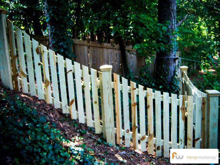 Scalloped Picket Fence On A Slope Picket Fences Wood Picket Fence Fence Landscaping Building A Fence