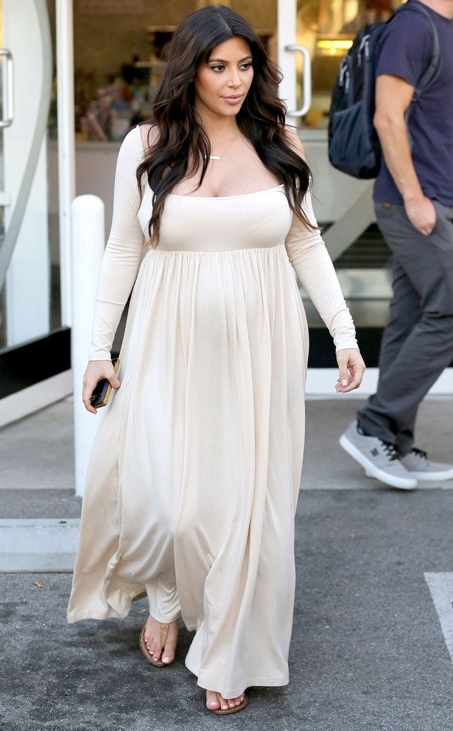 5b8d78122d90b Kim steps out for a little froyo in the very same dress Kourtney wore while  pregnant!