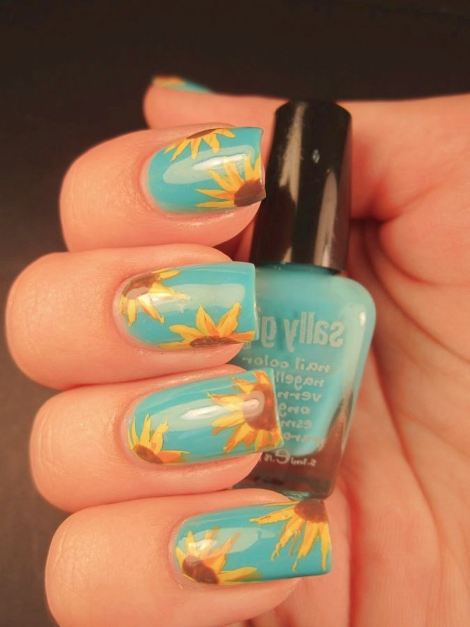 sunflower nail art--now that  heavy painting season has transitioned into garden season, I wonder if this would help my perpetual dirt-under-nails problem, or just end up being super chipped right away...