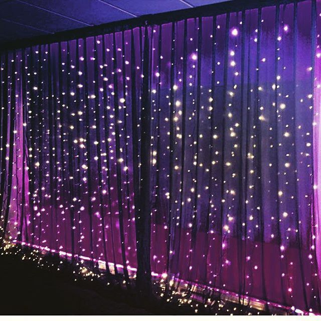 our black fairy light wall draping