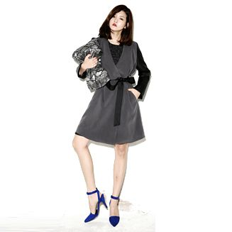 Designed like a classic morning coat,this shawl collar coat has an old-world,classic appeal. With it's to two-tone accent, mid thigh hemline, long sleeves and ribbon belt, definitely, you will have the best of both worlds. Look fab wherever you're heading by wearing an elegant dress underneath plus tights and knee-length boots.