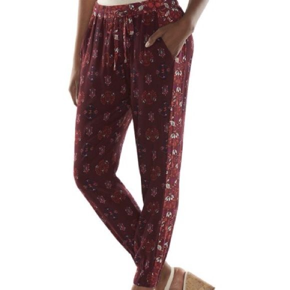 Printed woven joggers in red emblem PRODUCT FEATURES Graphic print Faux back pocket 2 front pockets Elastic cuffs FIT & SIZING 27'' inseam Drawstring elastic waistband FABRIC & CARE Rayon Machine wash Imported- stunning color- in burgundy- red- black- coral and mint! - I will create a listing for you with your size preference! Pants Track Pants & Joggers