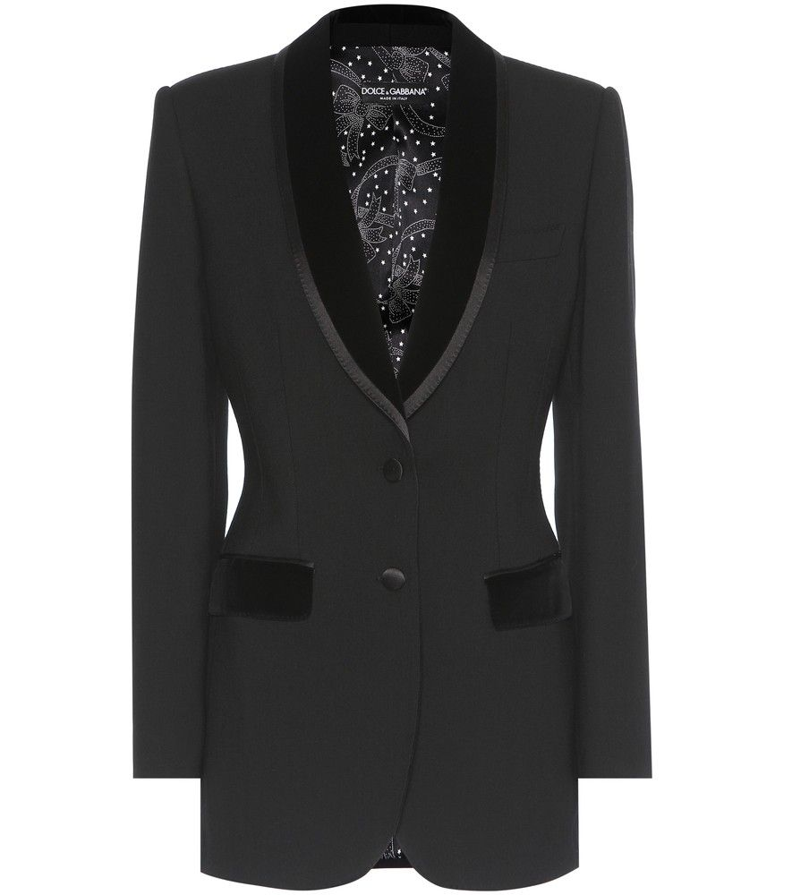 Dolce & Gabbana - Wool blazer - Slip into a classic look with Dolce & Gabbana's black wool blazer. Carefully tailored in Italy, this style features a velvet trim along the lapels and pockets, as well as smooth satin buttons. The shoulders have been lightly padded for a sharp finish. For a sophisticated look, we're styling this with a high-neck silk shirt. seen @ www.mytheresa.com