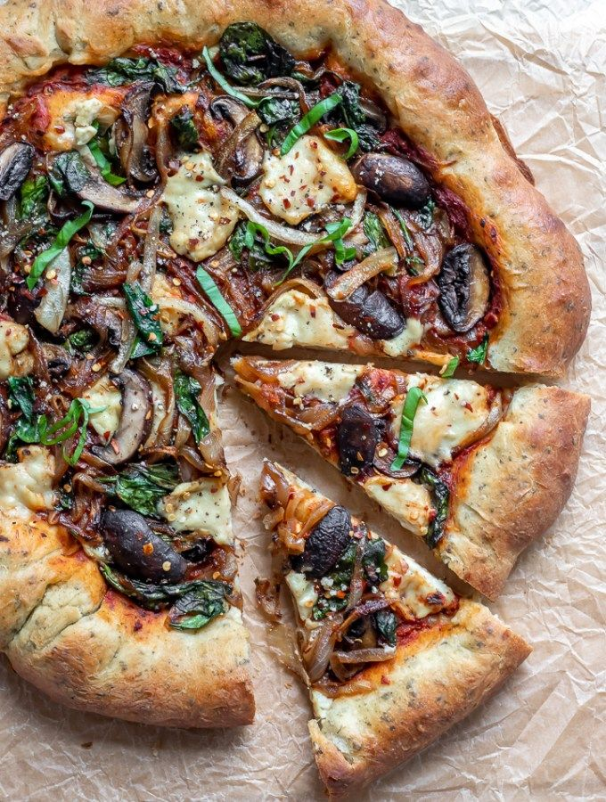 Vegan Stuffed Crust Pizza! With quick and easy vegan cheese, a crisp yet chewy herb crust, and caramelized onion, mushrooms and spinach, it's time for pizza night!