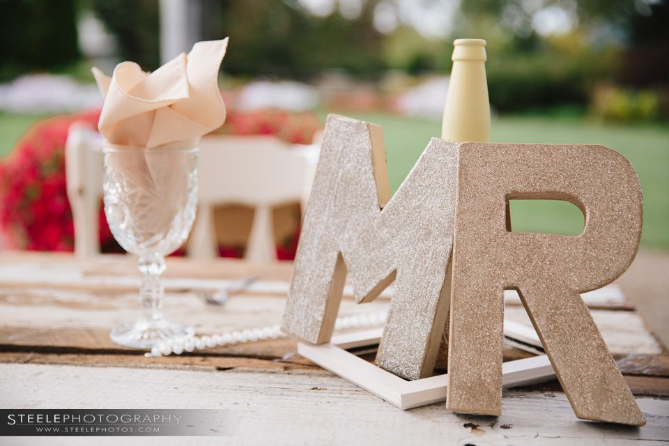 Hey MR. Cute details for head wedding table.  www.steelephotos.com