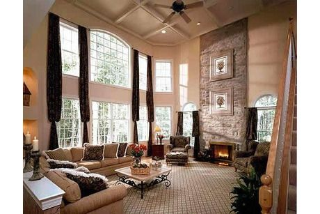 Coffered ceilings above a two-story stone fireplace and a ...