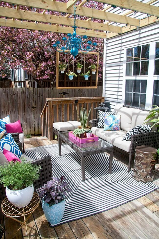 Charming Outdoor Seating Area with Colorful Touches ... on Outdoor Living Ideas On A Budget id=13178