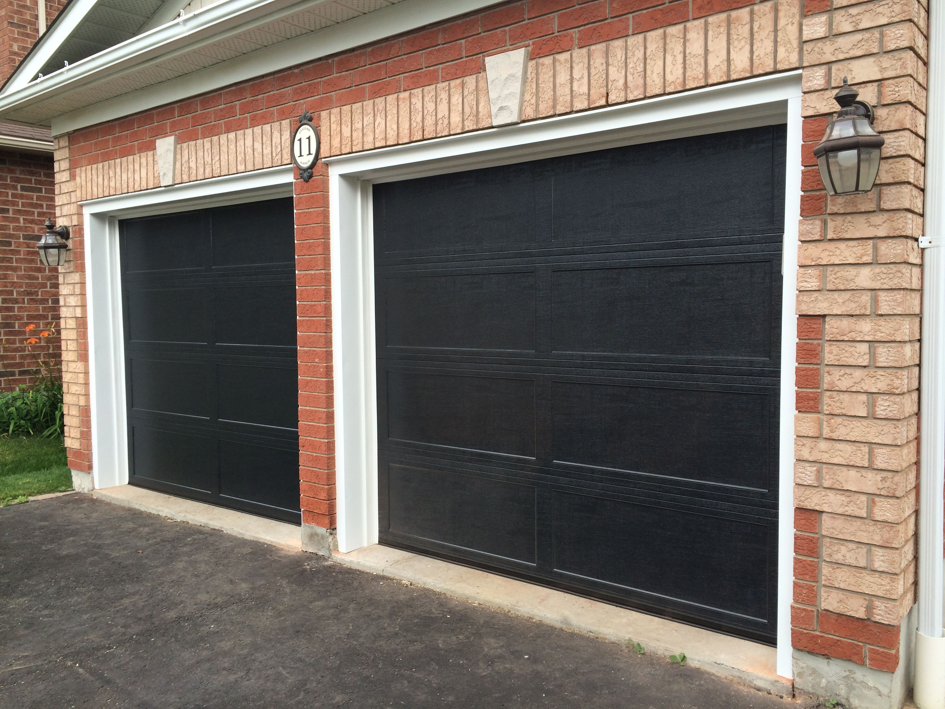 8x7 Haas 673 Recessed Panel Black Doors With White Aluminum Capping Garage Doors For Sale Garage Doors Modern Garage Doors