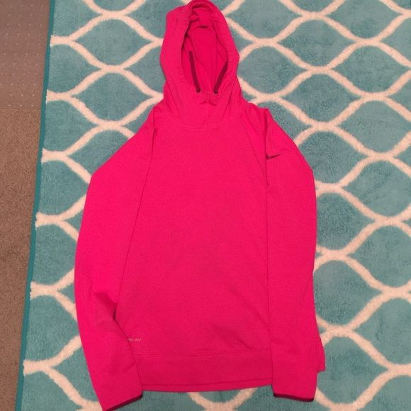 REDUCED  Nike Pro hoodie! Pink long sleeve Nike Pro Dri fit hoodie. Fleece lined for warmth. Has thumb holes in the sleeves and the Nike swoosh on the upper left arm sleeve. Got wash with a pair of new jeans so there is some faint staining see last picture for details. Nike Sweaters